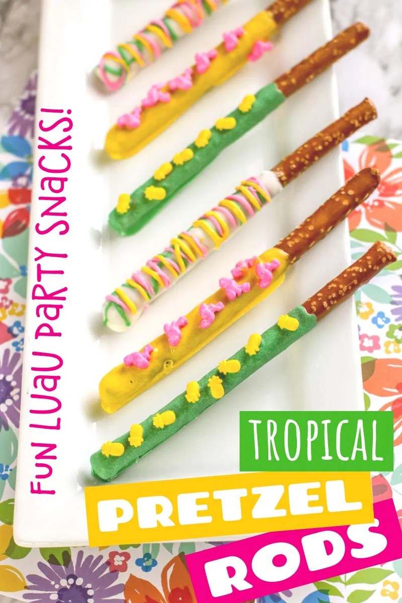 "Pretzel rods covered in colored melted candy and sprinkled with tropical themed sprinkles. The rods are laid on a white platter sat on a tropical background. Text overlay says""Fun Luau Party Snack - Tropical Pretzel Rods"" Photos of the recipe are similar throughout from various angles and with different text overlay, unless otherwise described."