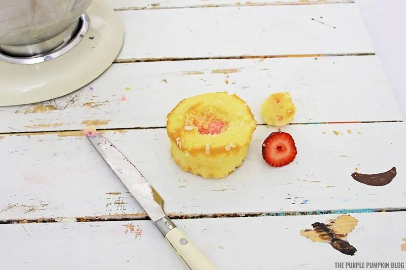 Filling cupcake with strawberry filling