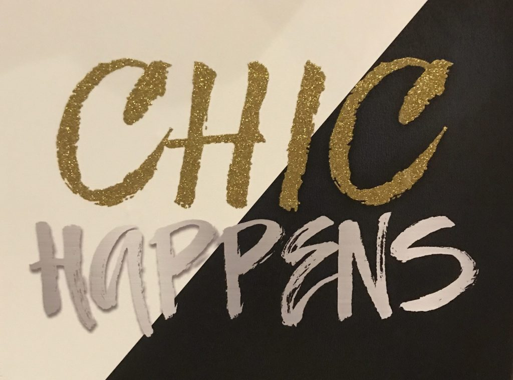 "Sign, says ""Chic Happens"""
