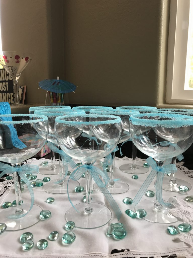 "Here are the champagne glasses, with the rims ""pre-sugared."" This is another thing you can do ahead of time, so you don't have so much ""last minute"" flurry! I'm all about making the day of the party easy and fun! Nobody wants a stressed out hostess!"