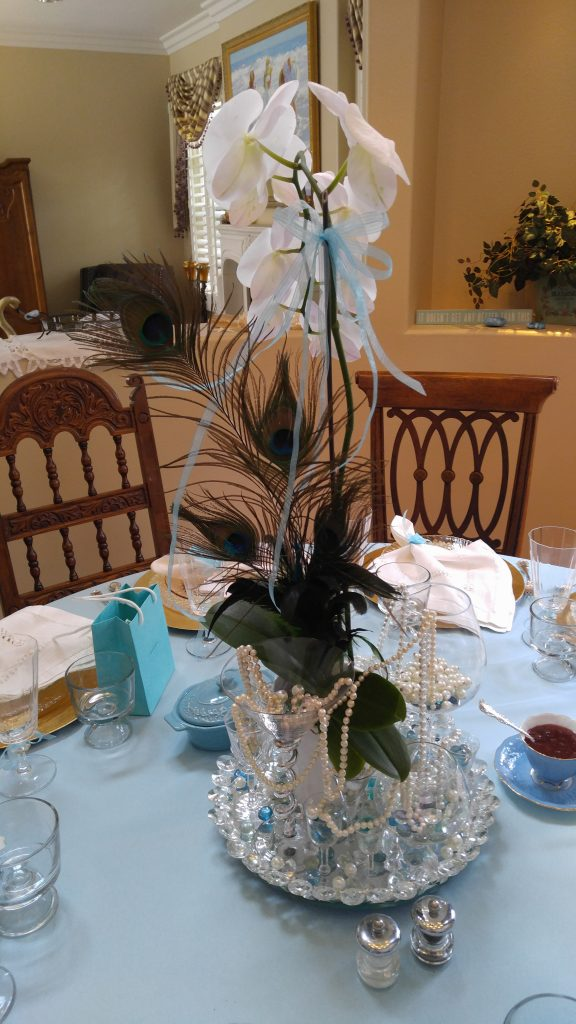 A close up of the table centerpiece just before the party. I just put together some vintage glasses, blue glass, an orchid and pearls I had around the house. In the background on the table you can see the little Tiffany bag that Don snuck in- with a surprise gift for me!
