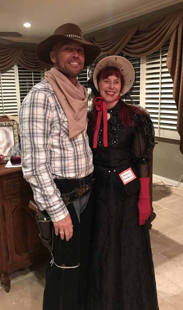 "Johnny as P Elvis Swagarin - a lonely gunslinger, and Geralyn as Helena Handcart, mother of the 13 ""Handcart Boys"""