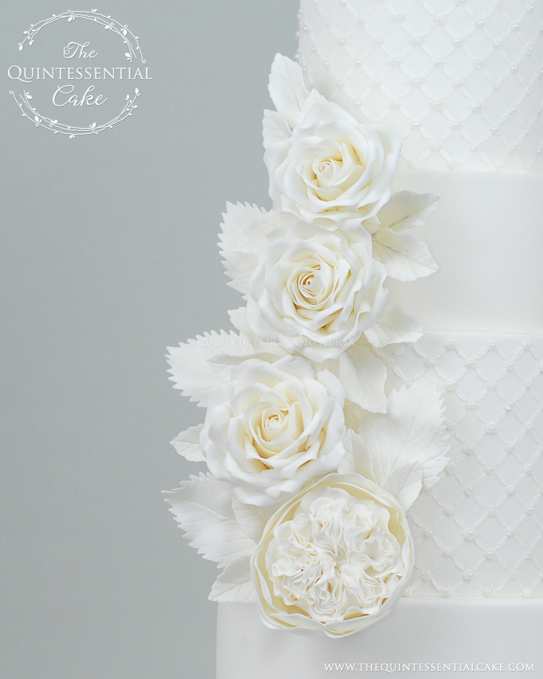 All White Wedding Cake With Sugar Roses And Pearls The