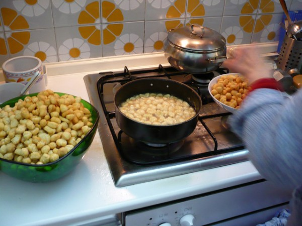 frying struffoli by Emma