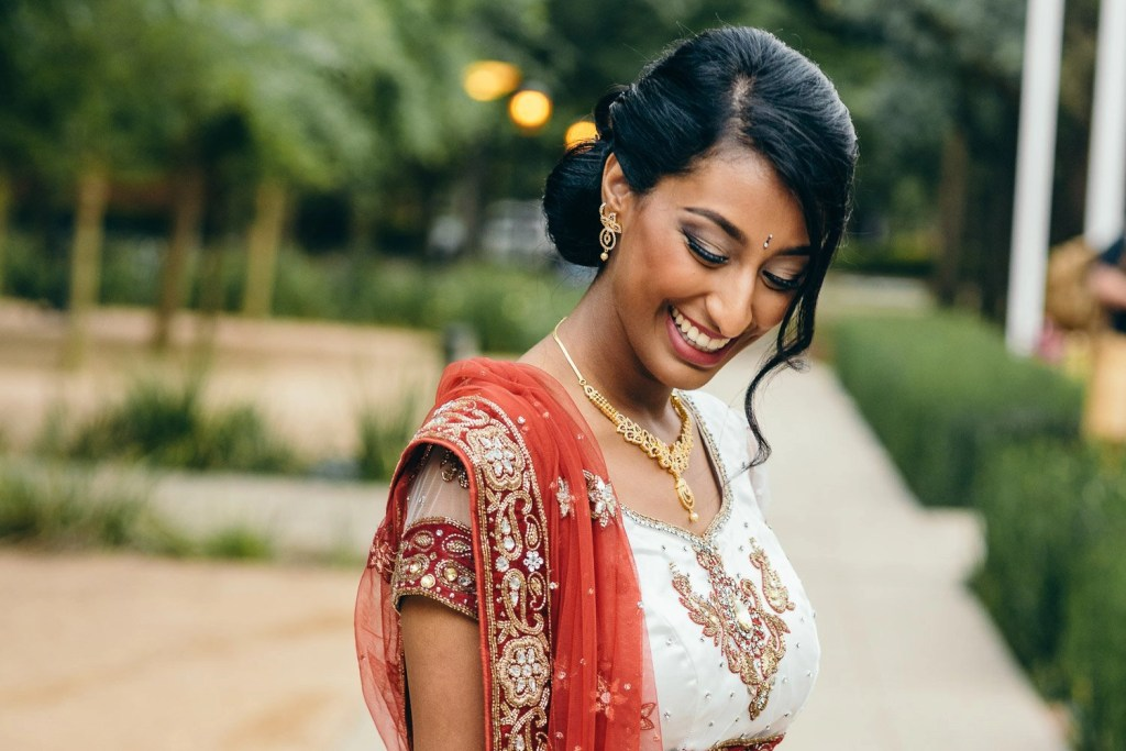 indian bride in a traditional red lehenga at rice university