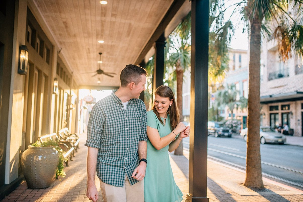 a couple laughing for their fun Galveston engagement pictures