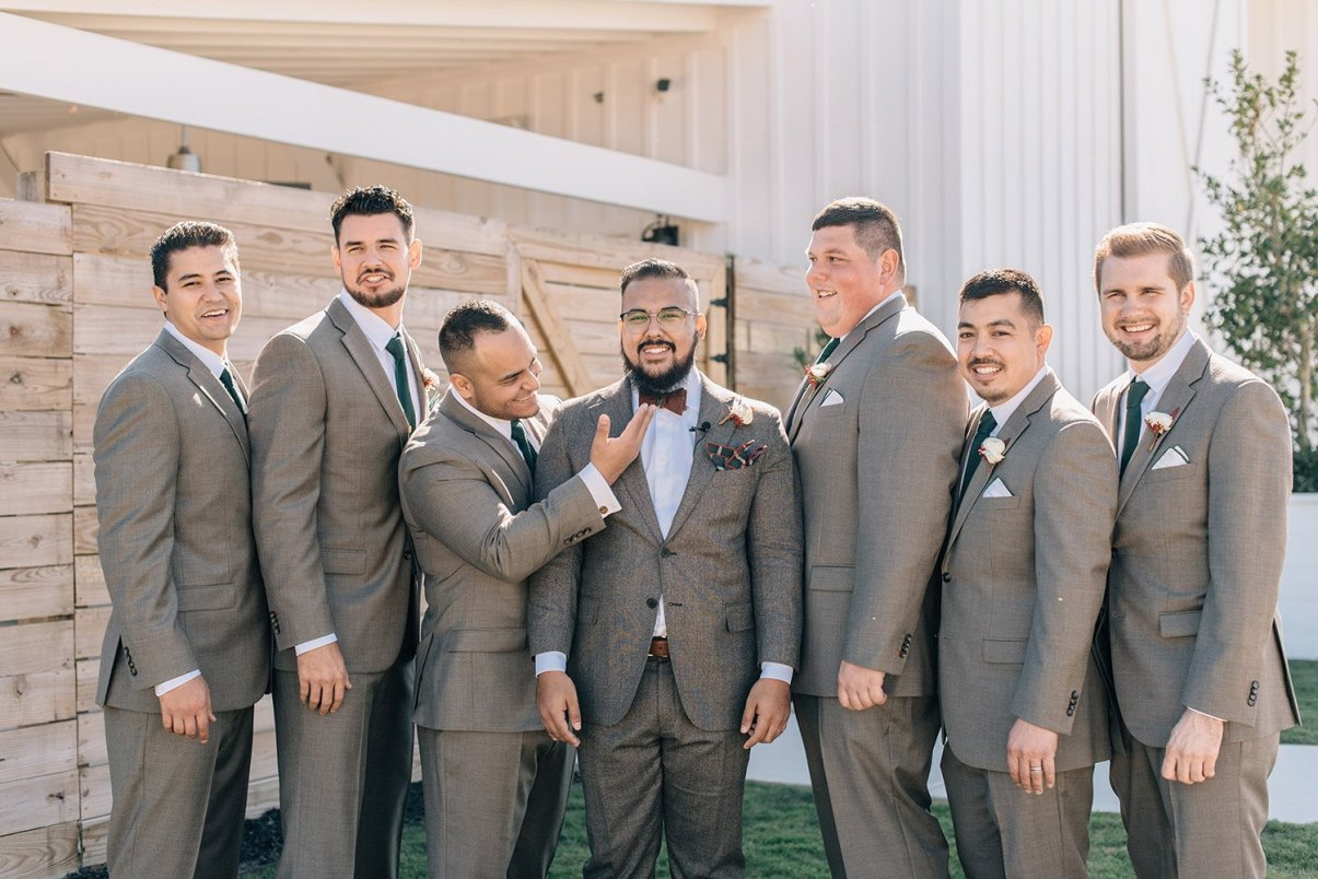 groomsmen and groom laughing