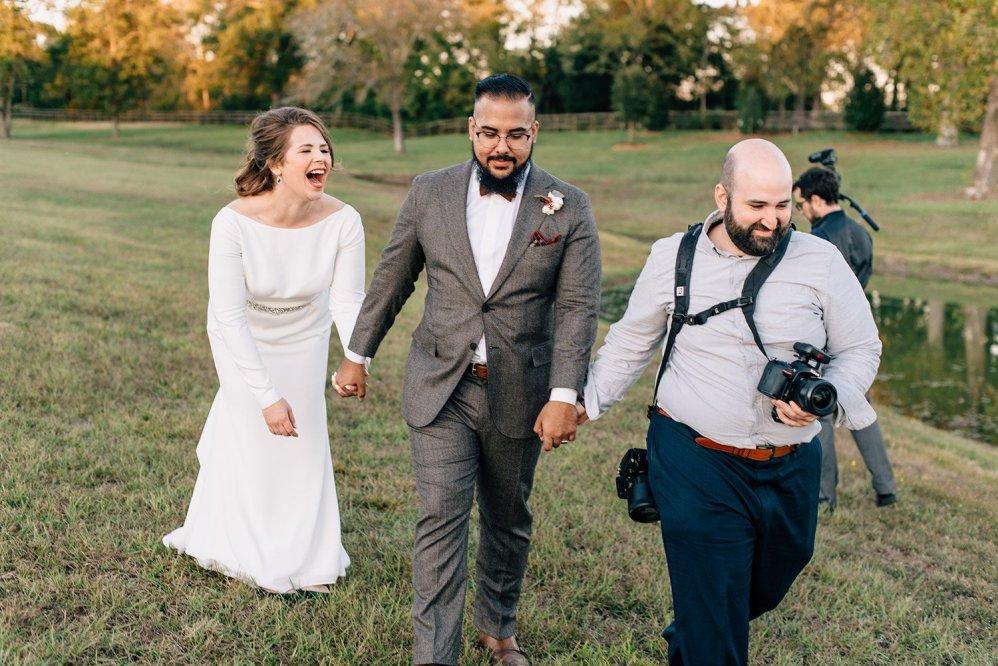 bride groom and photographer walking