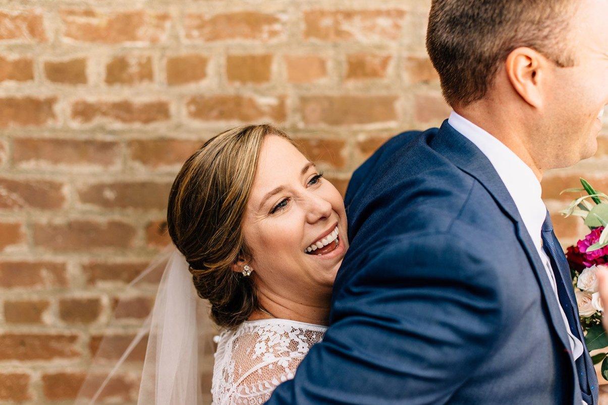 bride giving groom bear hug