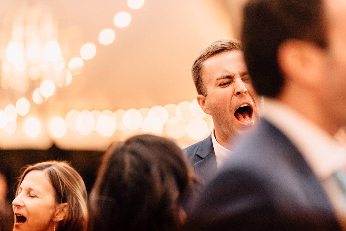 groom celebrating at wedding reception