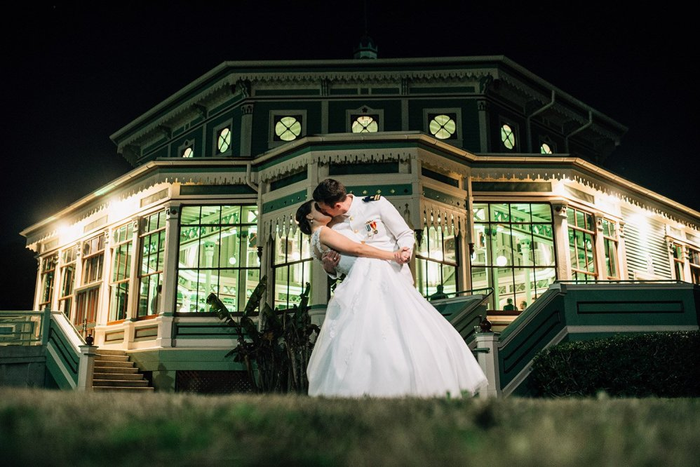 groom dips bride in front of their Galveston wedding venue, Garten Verein