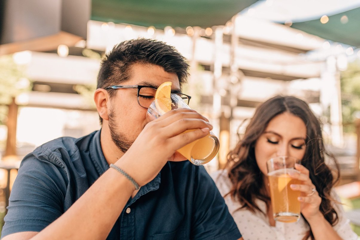 engaged couple drinking beer