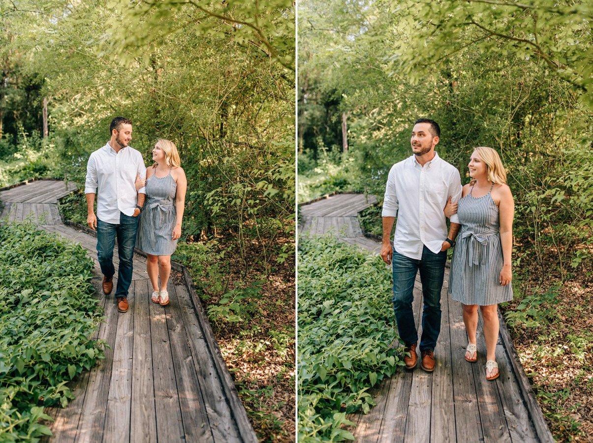 engaged couple walking in the houston arboretum
