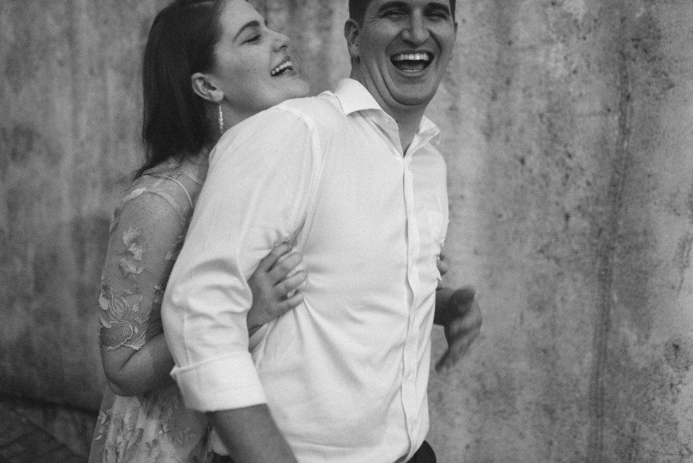 couple laughing outside Tiny boxwoods