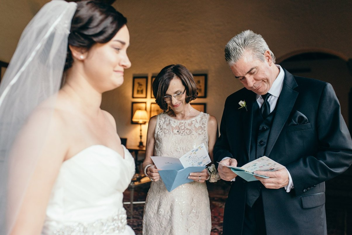 parents reading notes from bride