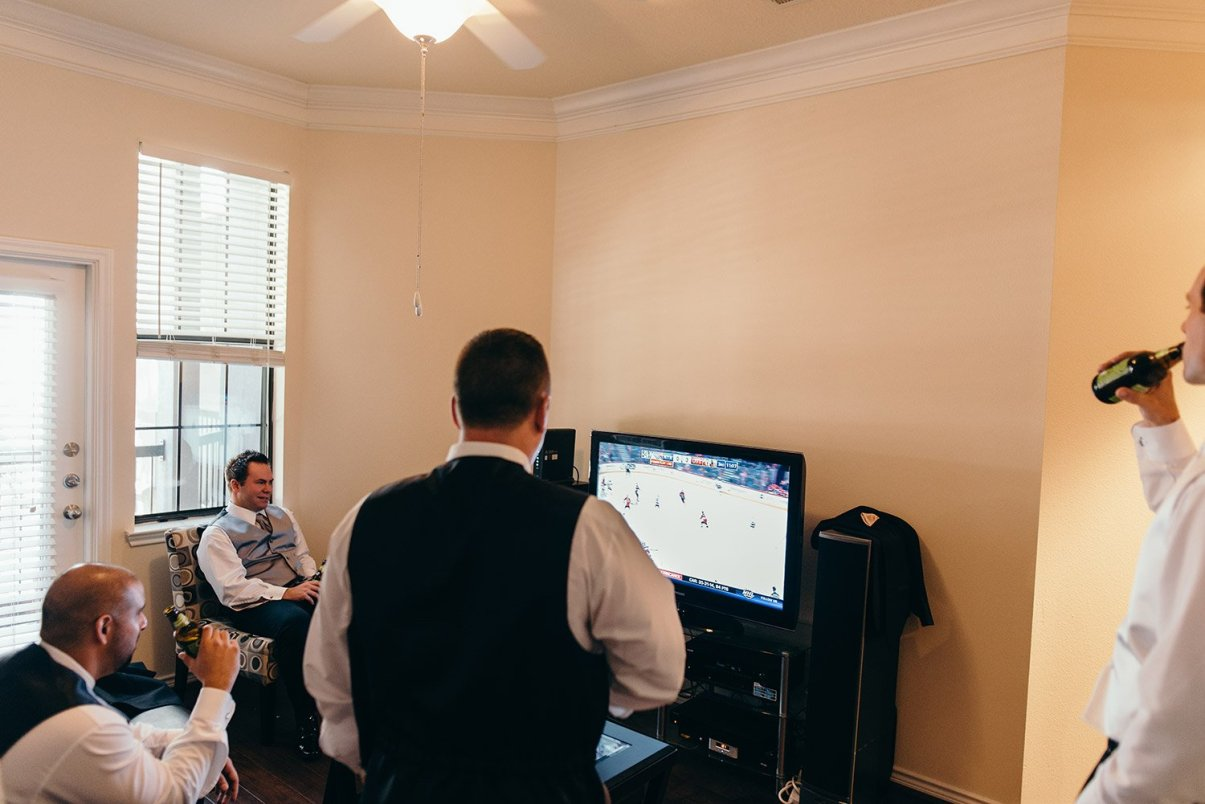 groomsmen watching tv