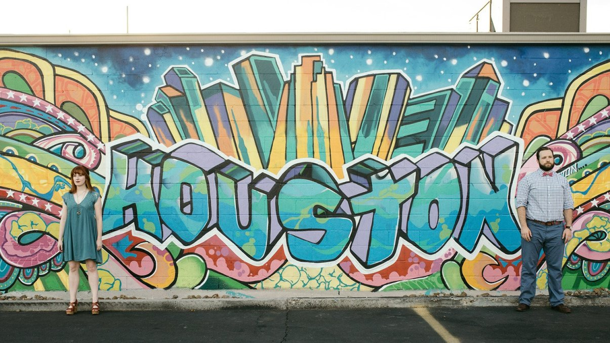 engaged couple and houston graffiti wall