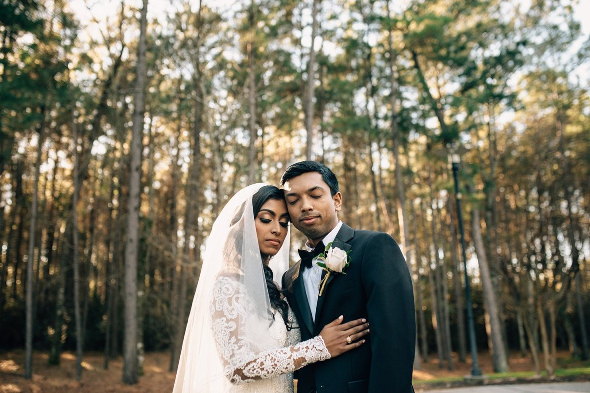 bride and groom portrait outside at chapel in the woods