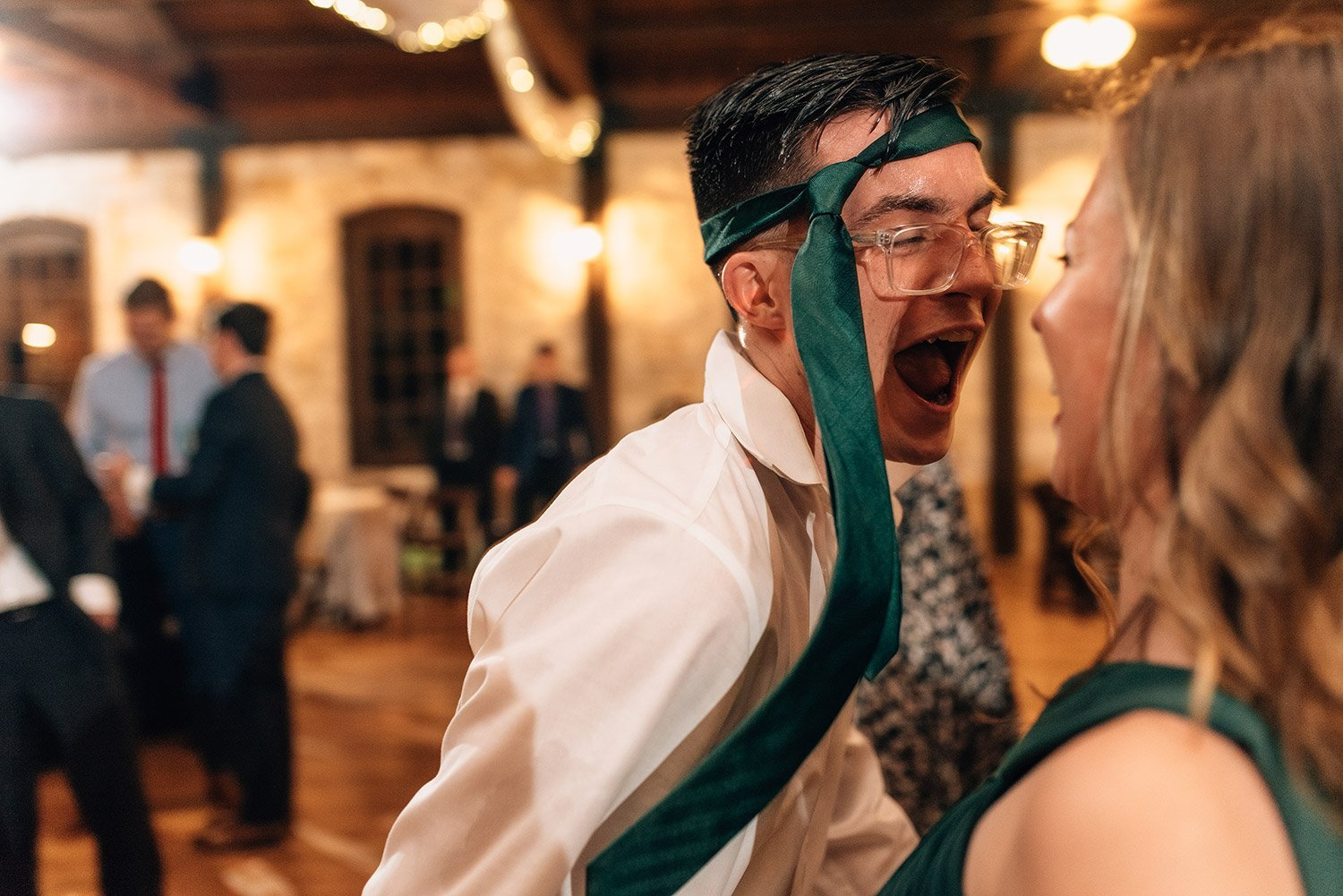 wedding guest with tie on his head
