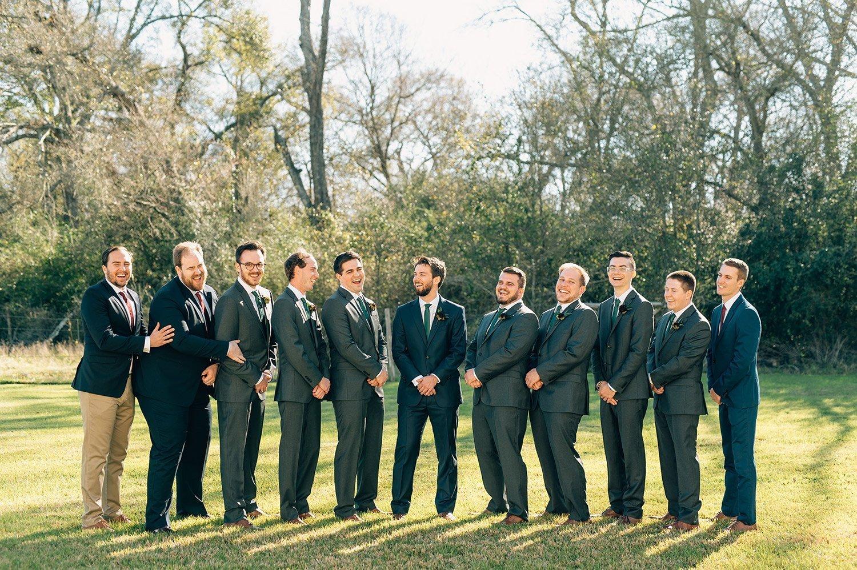 groomsmen in grey suits and green ties