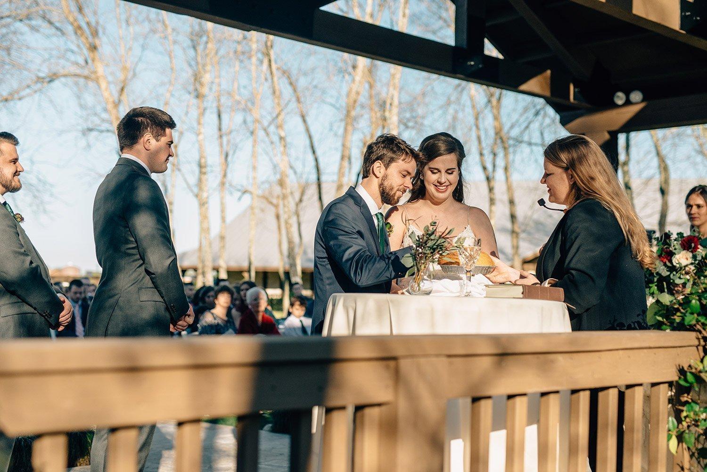 couple talking communion during wedding