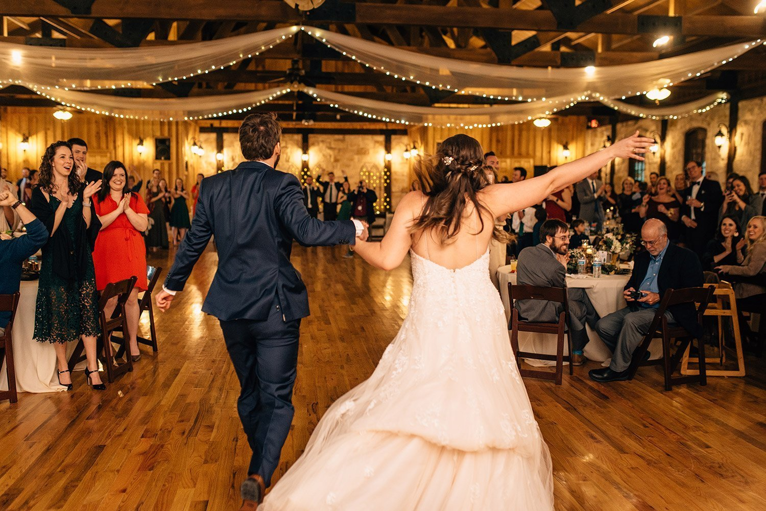 bride and groom entering reception of their wedding at the springs event center