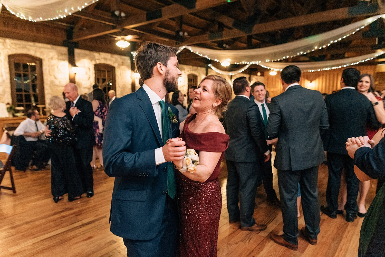 groom dancing with his mother at the springs event center