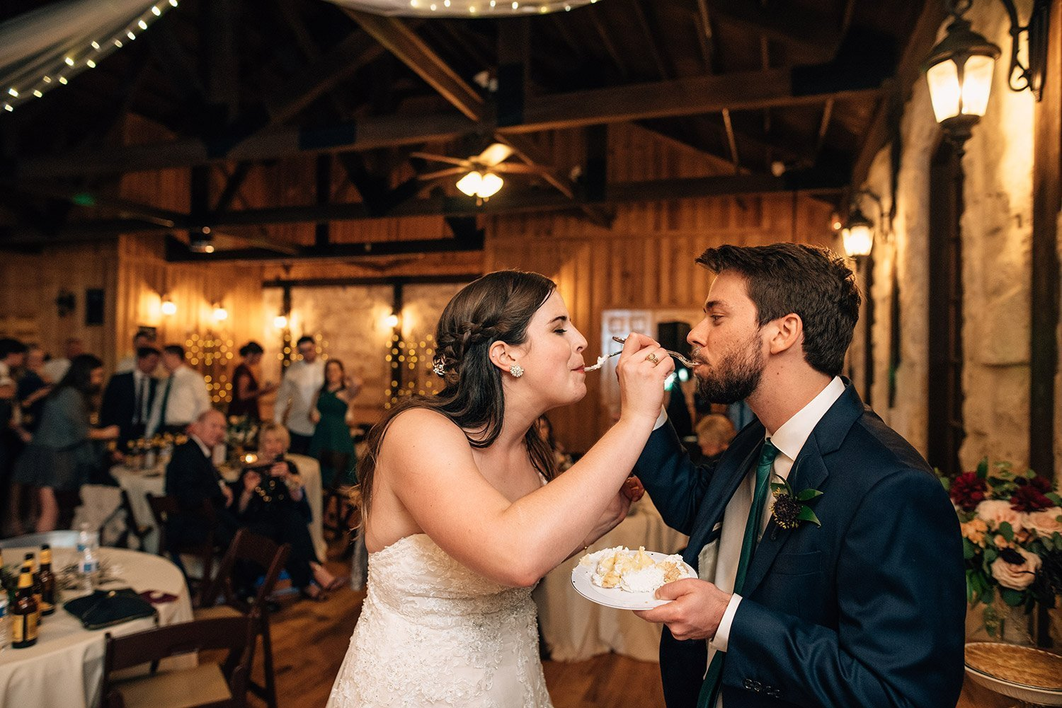 bride and groom feeding one another pie
