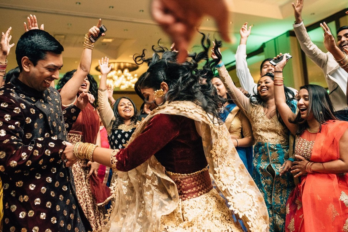 bride and groom dancing at Indian wedding
