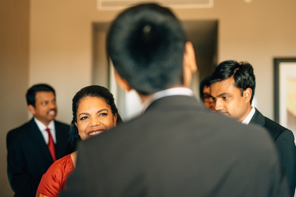 groom's mother looks at him with pride