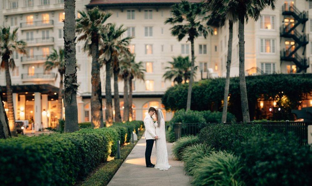 couple in front of Galveston wedding venue Hotel Galvez