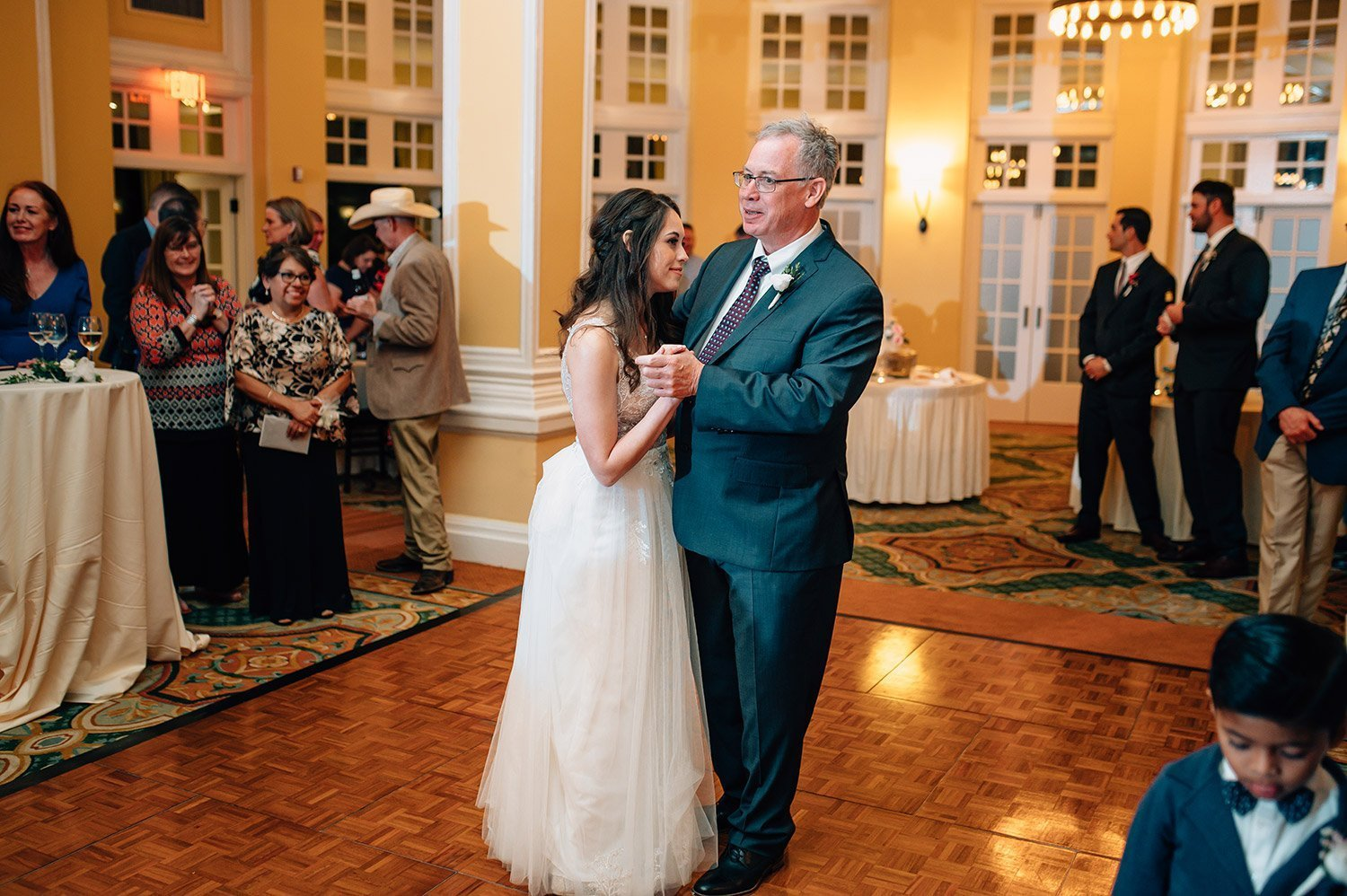 father of the bride dances with bride at her sweet wedding at hotel galvez