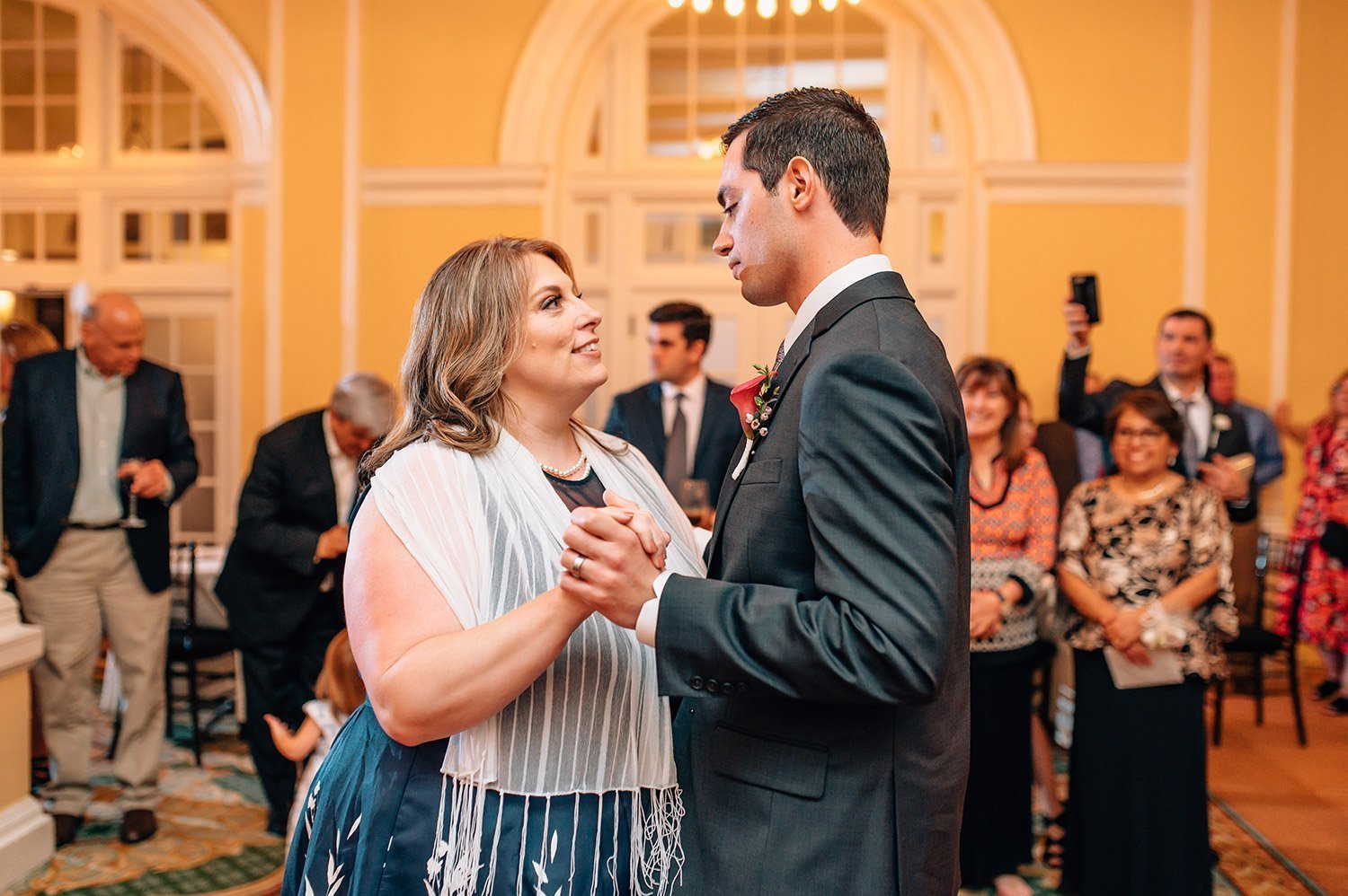 mother and son dance at wedding reception at Hotel Galvez