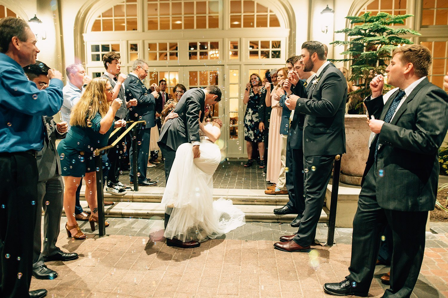 bride and groom bubble exit at Hotel Galvez