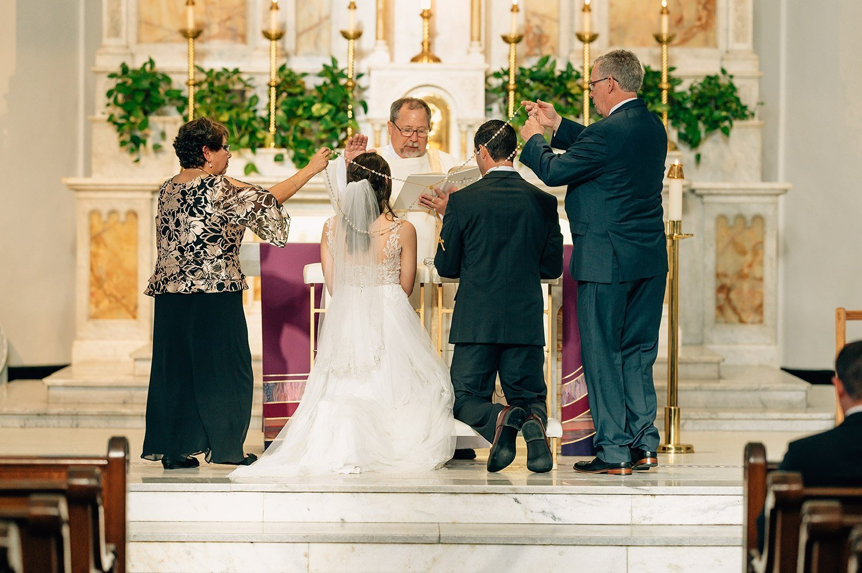 brides parents put the wedding lasso around bride and groom