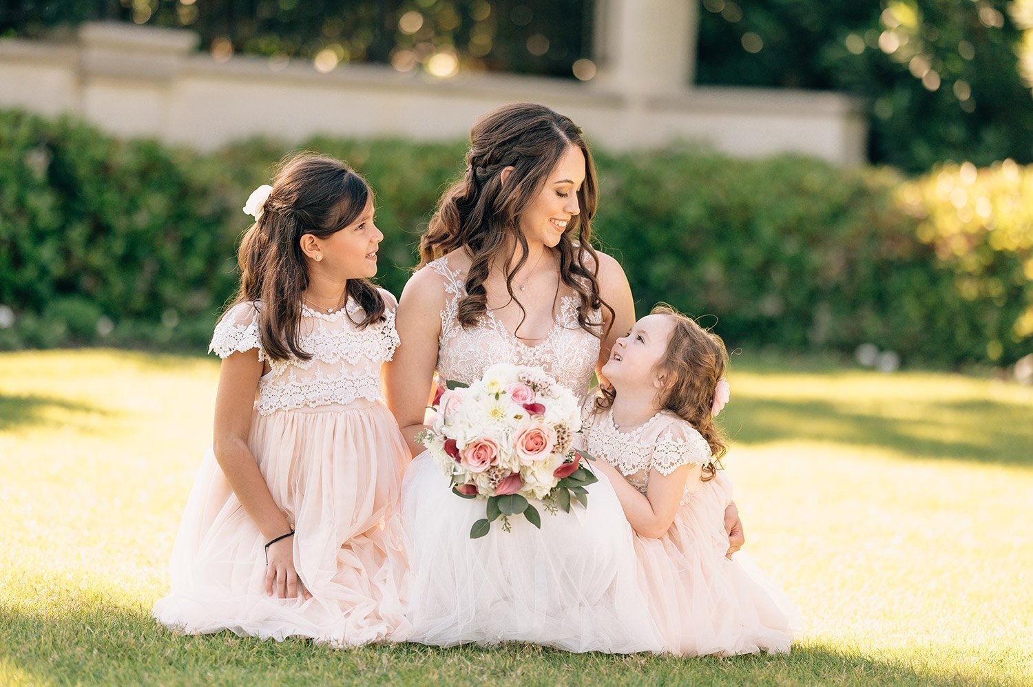 bride with flower girls before sweet hotel galvez wedding