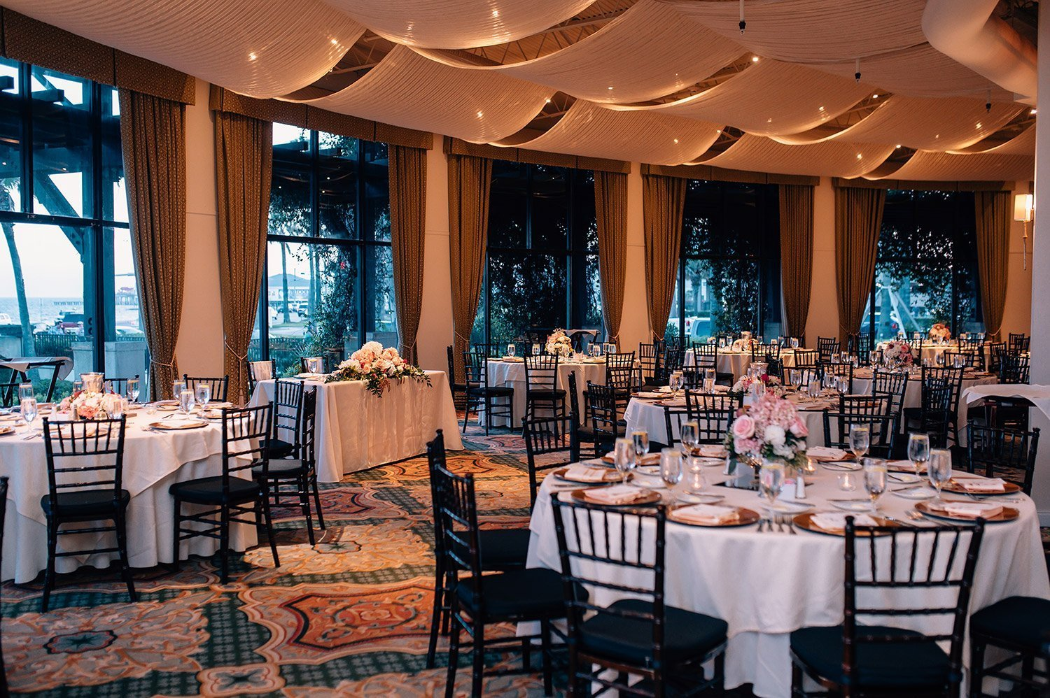 white table cloths and black chairs at hotel galvez reception
