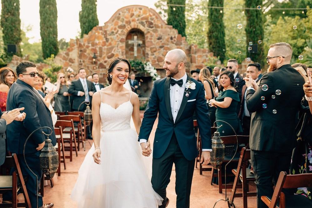 bride and groom recessional at madera estates