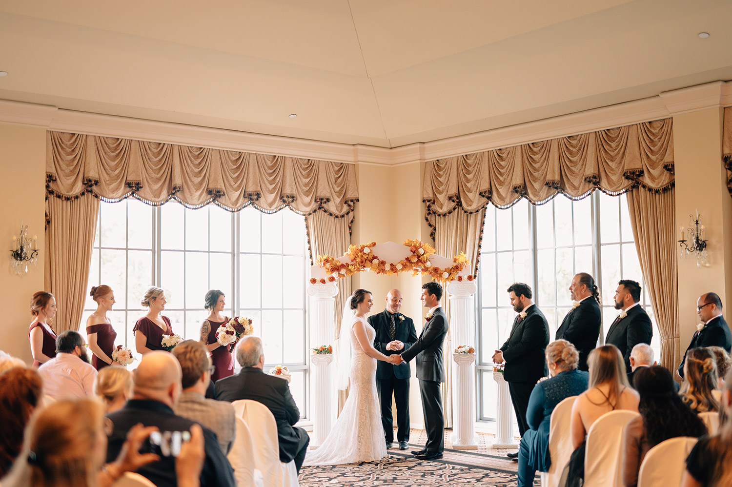 indoor wedding ceremony at sweetwater country club