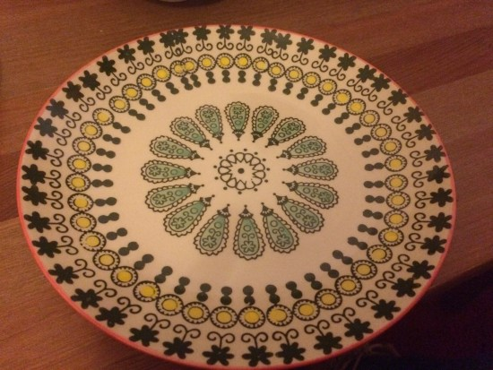 Stoneware plate with green flower pattern