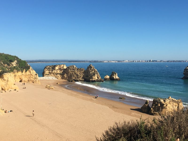 Praia Dona Ana beach in Lagos, Algarve, with golden sand, blue waters and rock formations - one of the best beach destinations.