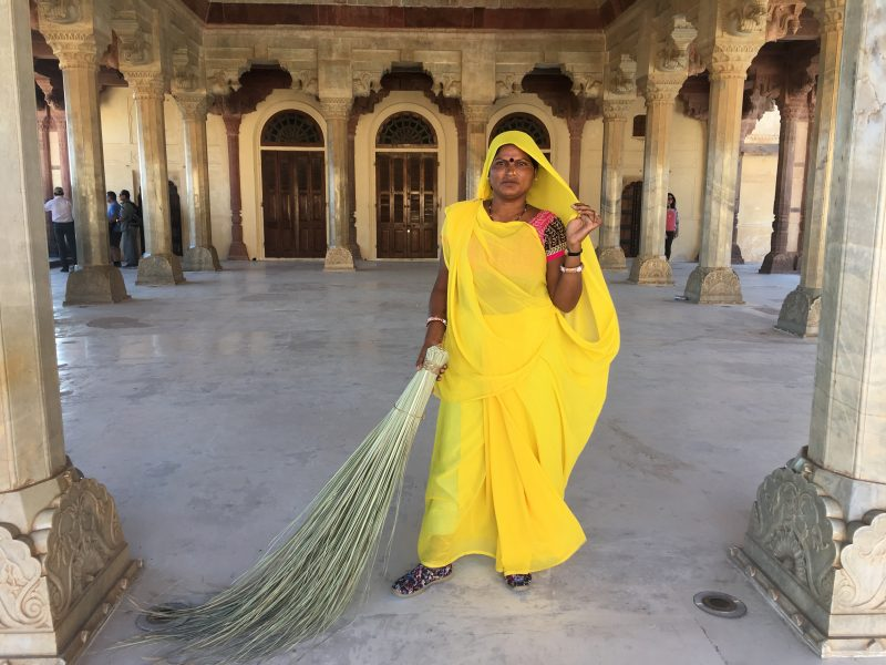 A staff member sweeping the floor at Amber Fort, Jaipur