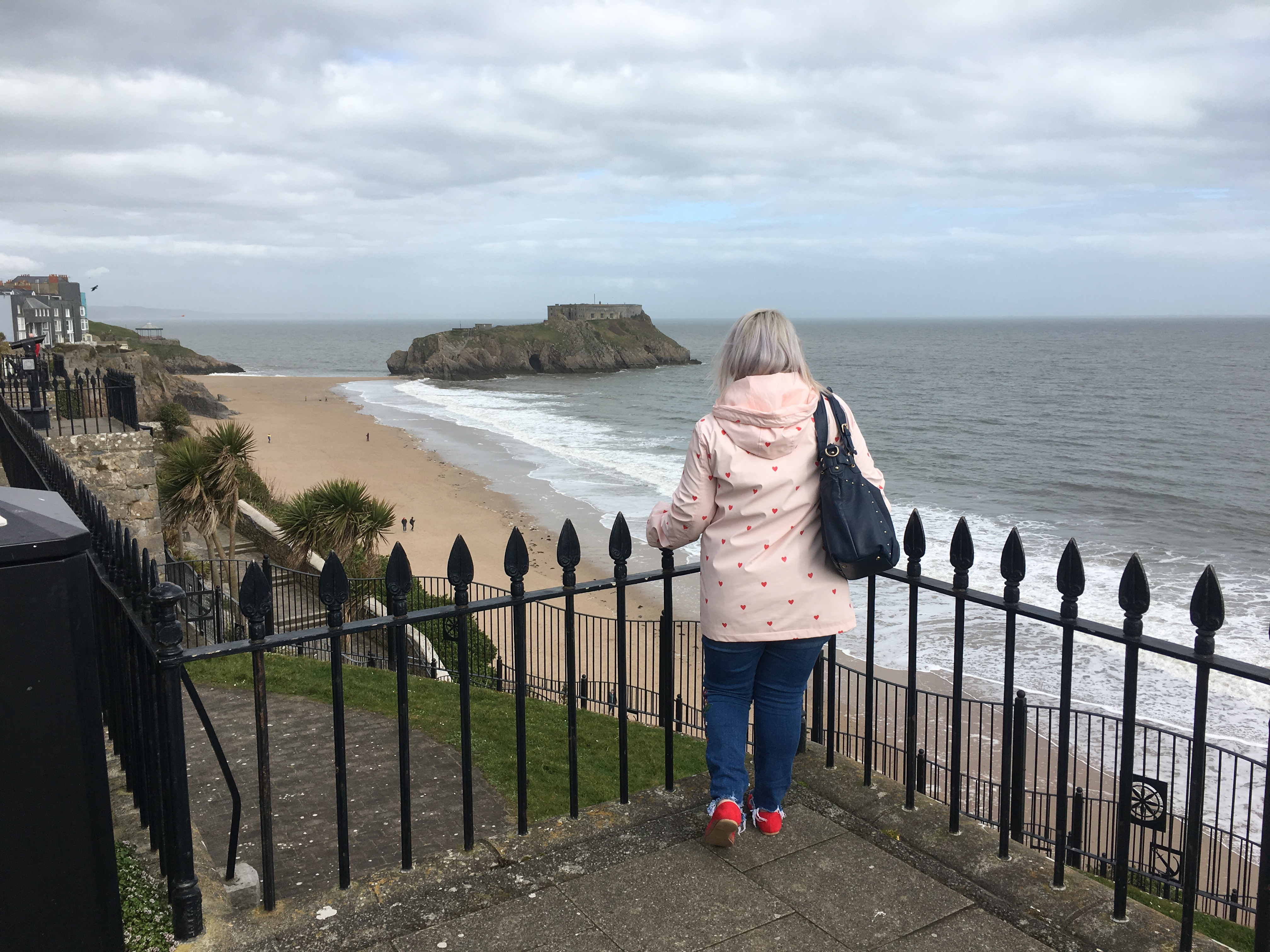A girl pictured looking across to St. Catherine's Fort, Tenby