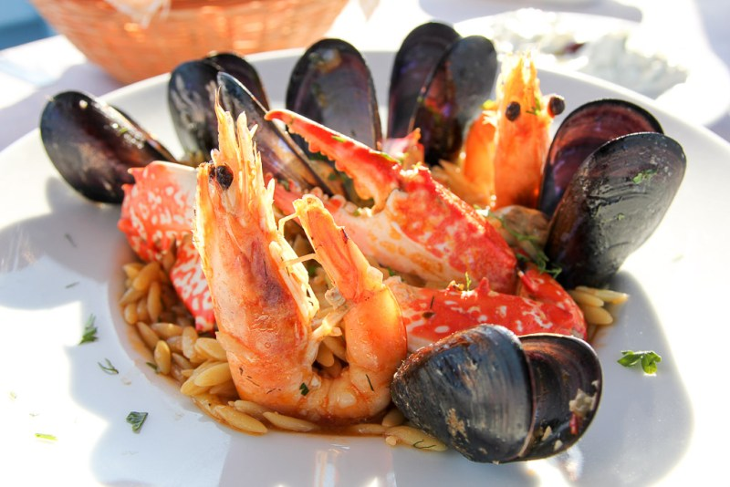 A platter of fresh shrimp and mussels on a bed of rice - a traditional Greek dish
