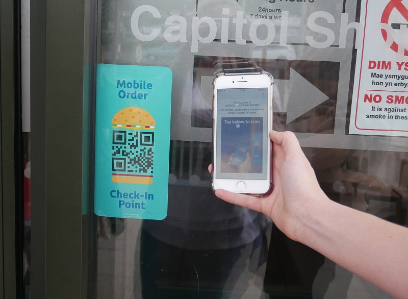 Scanning the McDonald's store code on a phone to order McDonald's via Click and Collect app