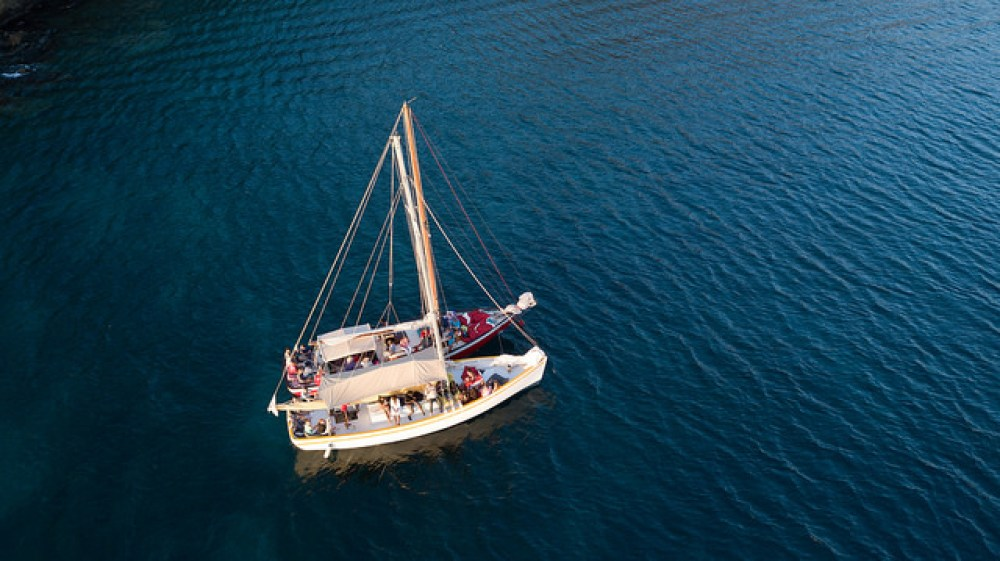 Overhead photo of two boats anchored up and tied together during a sunset cruise with Savvy Sailing, Grenada