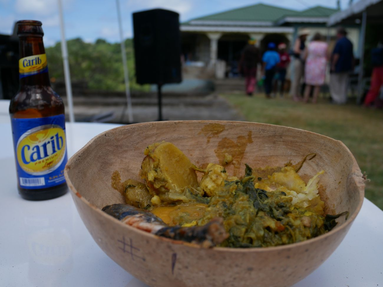 Traditional Grenadian oildown served in a Calabash with a bottle of Carib beer