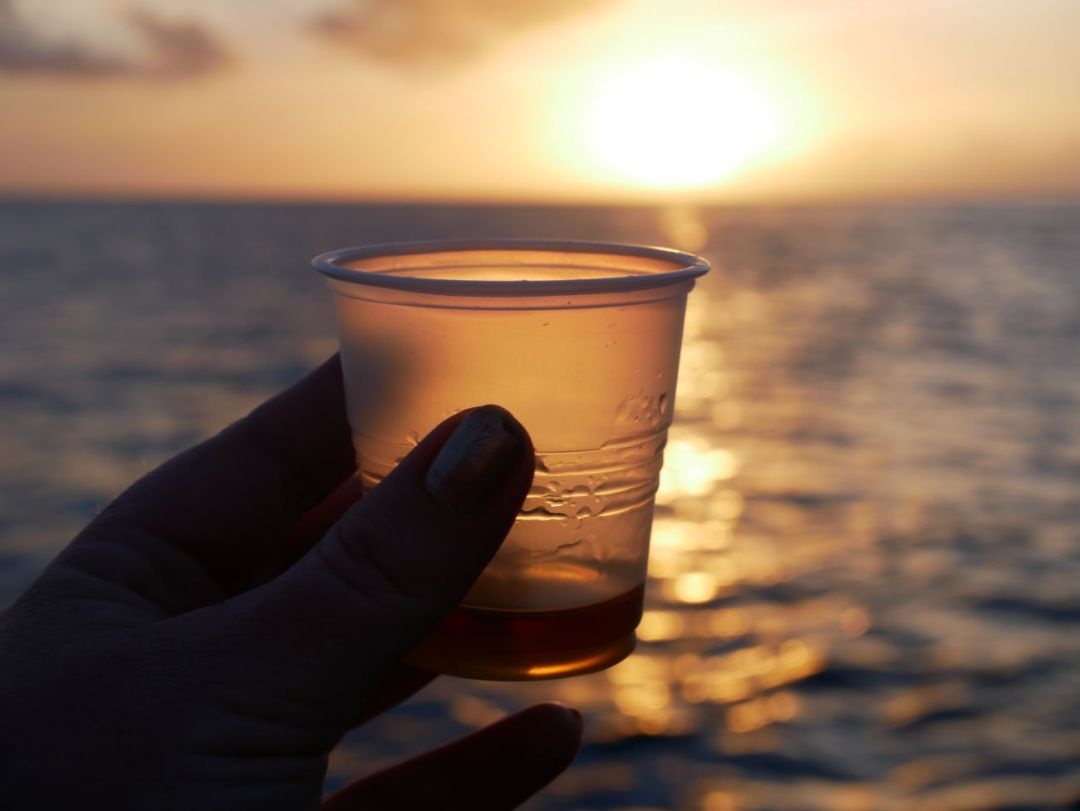 Rum tasting on board Savvy in Grenada for a sunset cruise