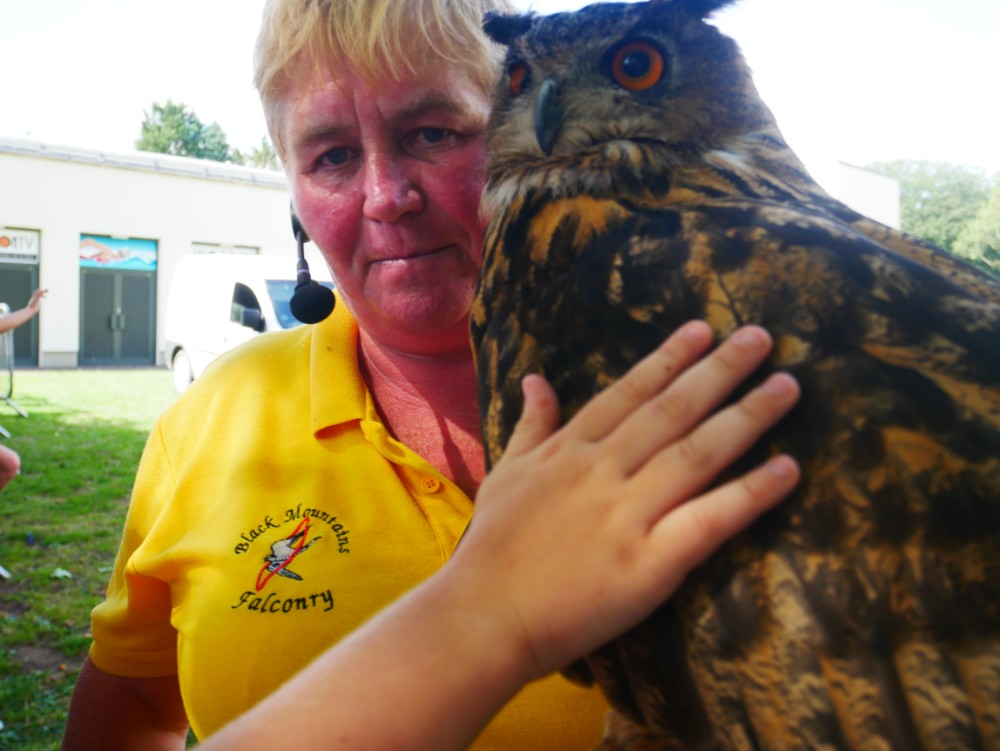 A lady holding an owl