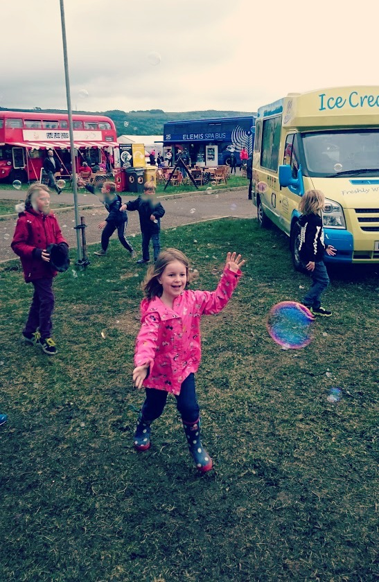 Boo chasing bubbles at Wychwood